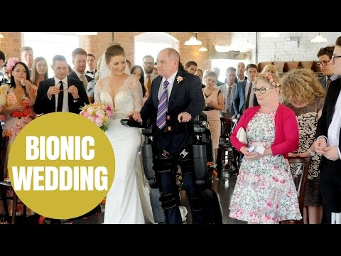 Paralysed dad walks daughter down aisle on wedding day in Derby