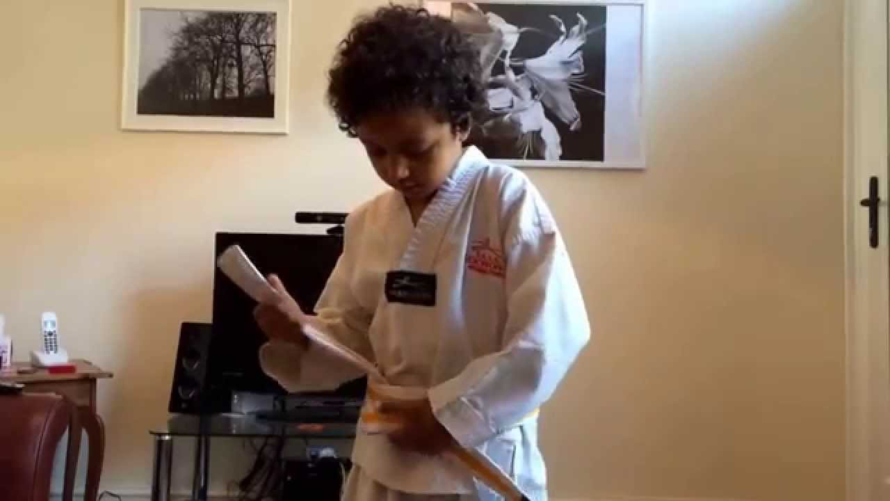 Joshua Shows Us How Tie A Taekwondo Belt