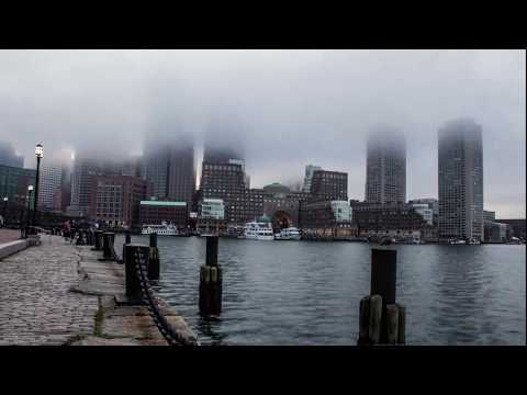 4K TimeLapse showing Storm Clouds covering Boston Skyline - Boston Harbor