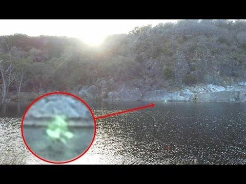 Ghostly glowing green figure walking on water in Marble Falls, Texas