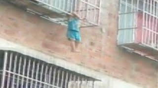 Passerby Rescues Boy with Head Stuck in Window Bars in South China