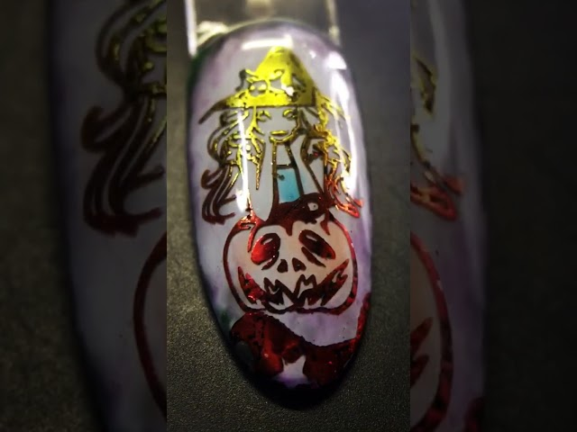 Idea_  Pumpkin witch Halloween foil nail art with sticky black stamping polish and jelly watercolor