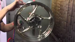 Spray Chrome on motorcycle rims - Alphalokgraphics workshop HongKong