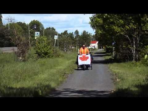 Andy's Million Bottle Pledge run as he goes through Douglas, New Brunswick.