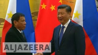 Philippines' Duterte warms China ties with Beijing visit