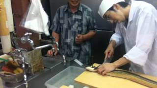 (part 1. Nailing the head) Japanese giant unagi (eel) preparation at a 5 star Japanese Onsen Hotel