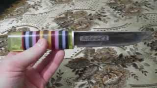 Нож с рукоятью из оргстекла.