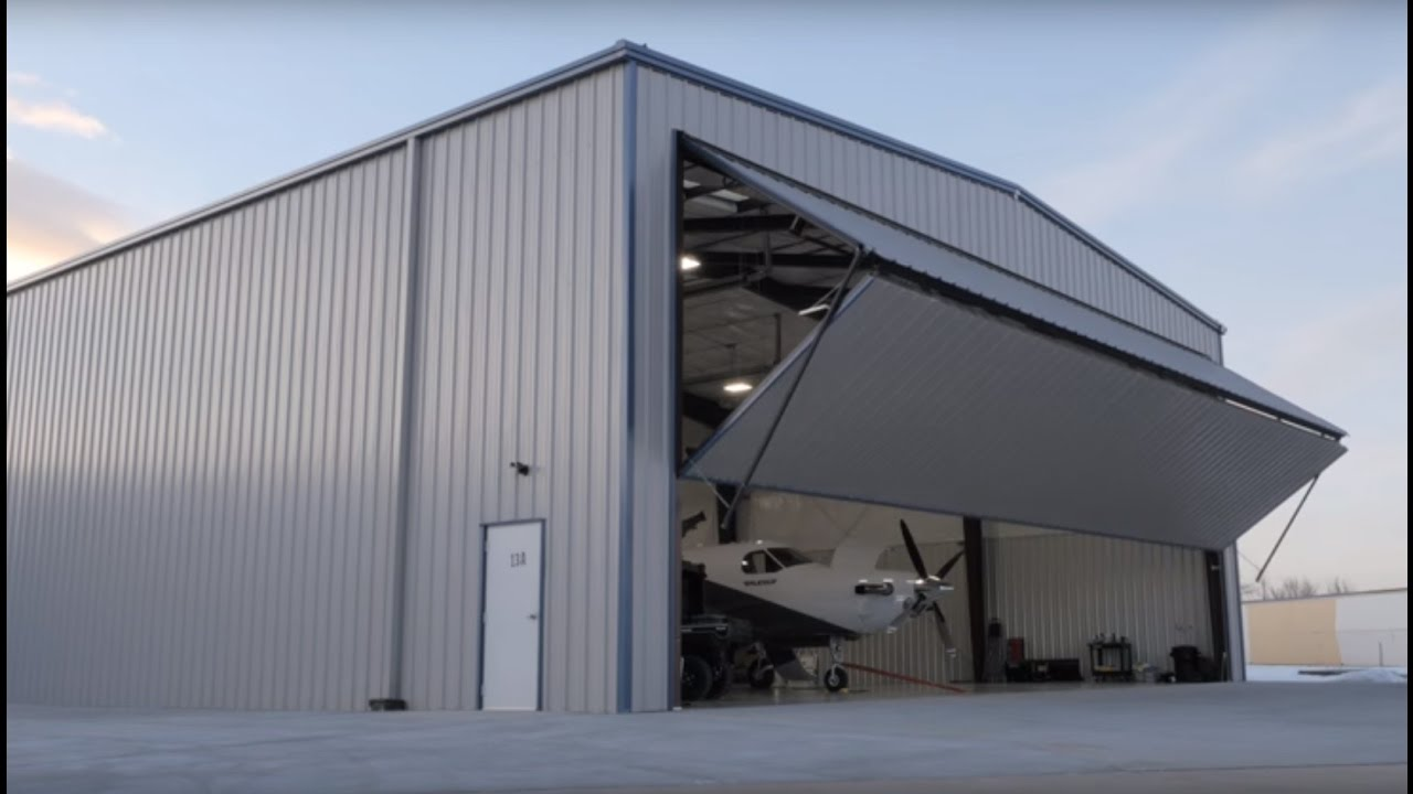 Commercial Steel Garages With An Overhand : Metal building outlet aircraft hangar project customer