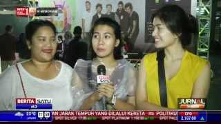 Ribuan Fans Rela Hujan-Hujanan Demi One Direction