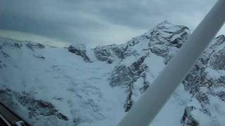 Flying Queenstown to Milford Sound, New Zealand, over the snow capped peaks