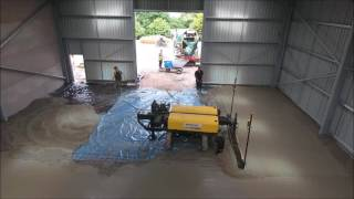 Concrete buggies working with ligchine boom screed in tight places