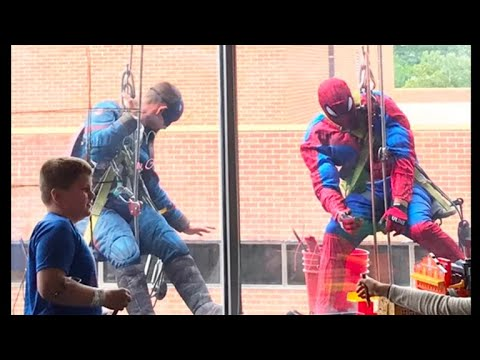 Window Washers In Superhero Costumes vs. Surprise Children At Iown Hospital