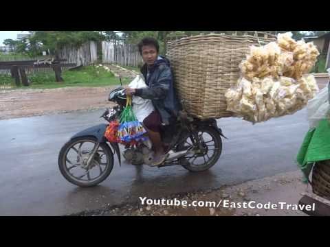 Myanmar motorbike travelling  cake sale man