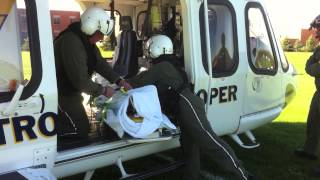 Hot loading of a patient into NJ State Police Helicopter Robbinsville NJ