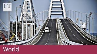 Vladimir Putin drives across new bridge to Crimea