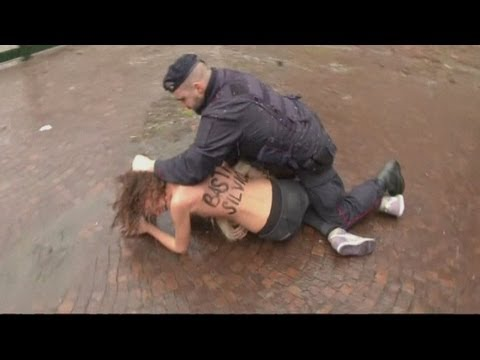 Naked Femen Protesters Target Silvio Berlusconi As He Votes In Milan