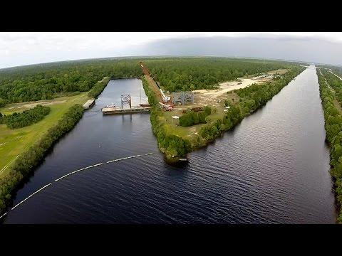 Crane Rental Corporation Loads Components on Barge