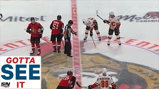GOTTA SEE IT: Wes McCauley Kicks Centermen Out So Tkachuk Brothers Can Face Off