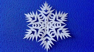 How beautiful it is to cut a paper snowflake.  Paper snowflake tutorial