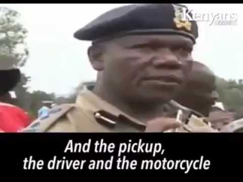 Kenya police officer reporting an accident