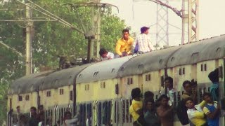 Incredible Indian Railways Extremely Dangerous : Foolish passengers sitting on EMU roof close to OHE