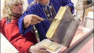 Strange Sliding Machine for Yummi Swiss Raclette - Hot Melted Cheese
