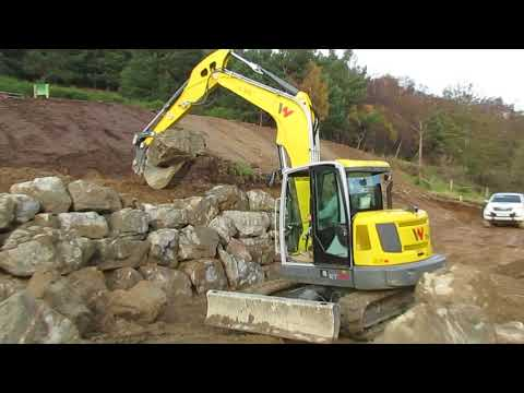 Davie Mitchell from Aberlour building a rock armour wall