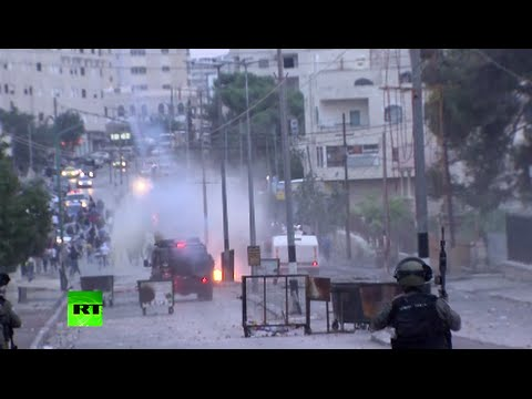 Palestinians hurl stones, Israeli soldiers fire tear gas, stun grenades as clashes grip West Bank
