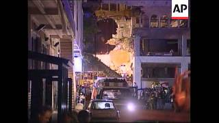 Injured and dead removed from collapsed building and s/bs with rescuer and injured woman