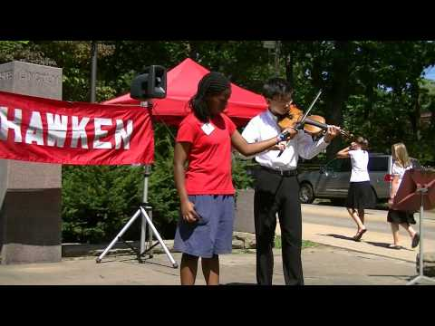 Hawken student plays violin at One World Day
