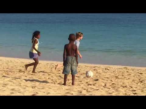 Madagascar beach kids playing - Mora Travel