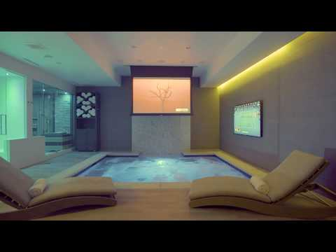 Luxurious Home Spa and Theater - Waterfall, Hot Tub, Sauna, Shower, Gym, and Lounge Seating