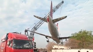 Crane Collapses And Drops Plane