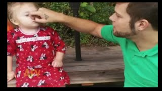 Funny : This girl is super impressed that daddy got her nose
