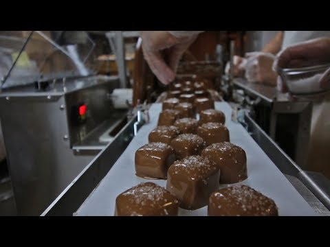 Chocolate Covering Sea Salt Caramels With The Enrober