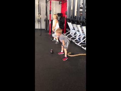 Jadon doing KB Swings during Kids CrossFit workout