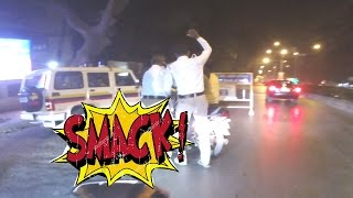 Police slapping squids at checkpoint