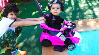 Sami and Amira play with pink car