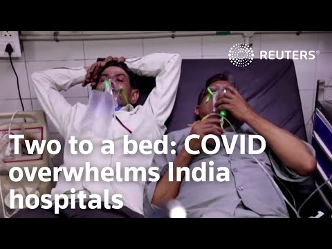 Two to a bed: COVID overwhelms India hospitals