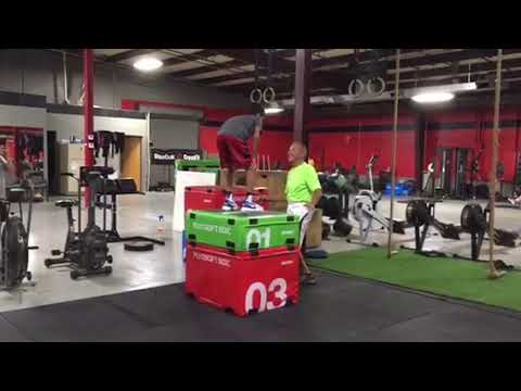 Box jump with approach at Solution One crossfit gym in Lenexa, KS