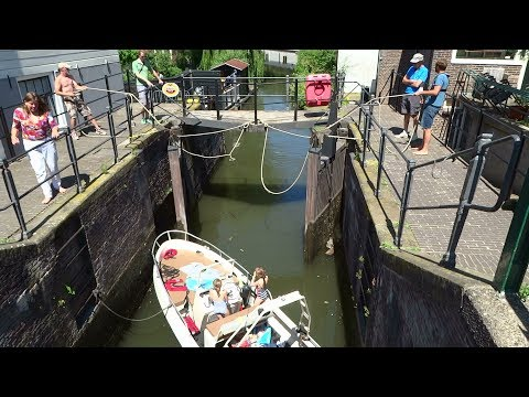 Boating in Amsterdam on the canals. river IJ, river Amstel, Nieuwendammersluis and more
