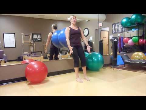 Squats Using A Big Exercise Ball
