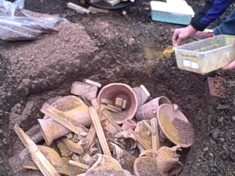 Pit firing pottery 1 - YouTube
