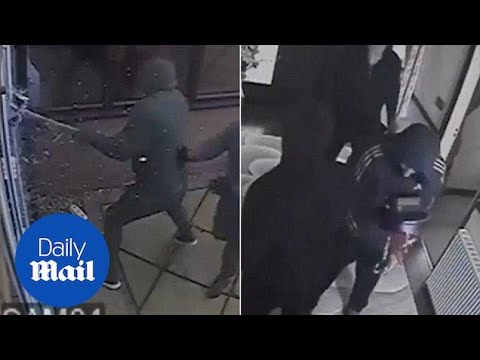 CCTV: Sledgehammer Robbers Smash Into Home With Teens Inside - Daily Mail
