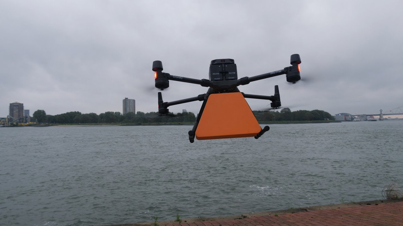 Drone delivers package to moving ship in port of Rotterdam