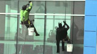 Superhero window washers clean St. Francis Children