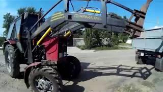 Разгрузка биг бегов трактором МТЗ 82 с Куном