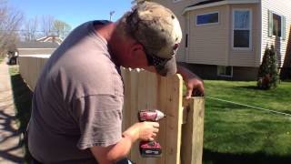Installing A Wooden Fence To Protect Kids, Pets