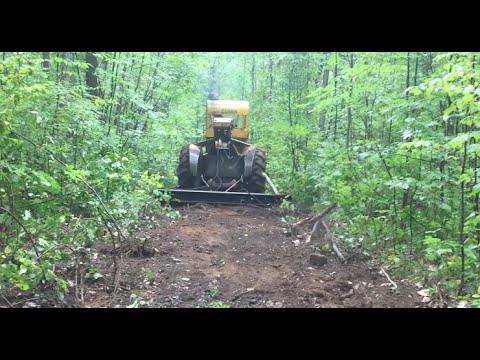 Road building with a Dozer track Drag behind the skidder!