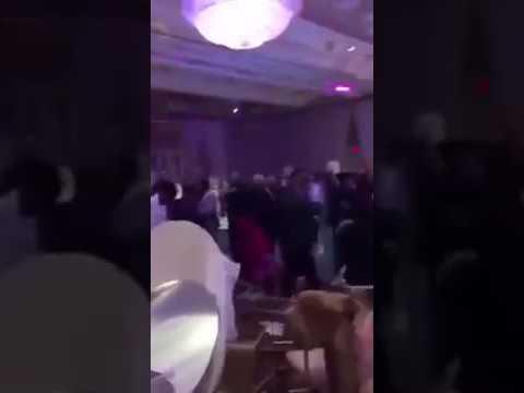 Fighting at wedding reception as bride